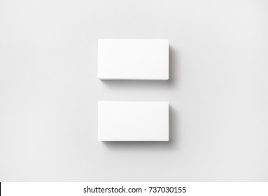 Blank white business cards on paper background. Mockup for branding identity. Template for graphic designers portfolios. Top view.
