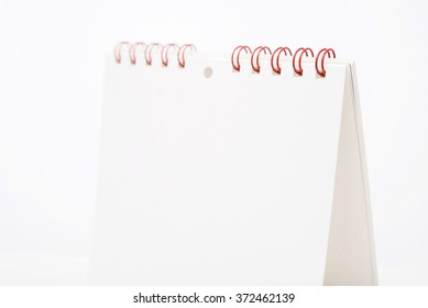 Blank white Calendar selective focus on red binders