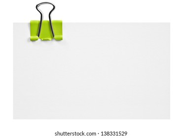 Blank white card with green clip on white