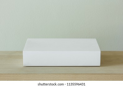 blank white cardboard package box mockup on wooden table