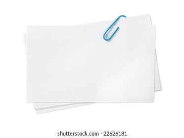 Blank white cards fastened with blue paperclip.  Clipping path included.