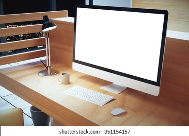 Blank white computer screen with lamp on wooden table at hight, mock up 3D Render