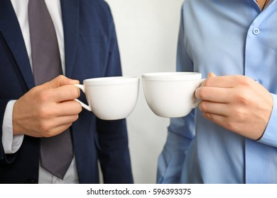 Blank white cups in hands, closeup