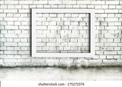 Blank white frame in empty grunge room