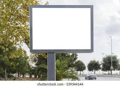 Blank white gaintboard advertising mockup in empty street