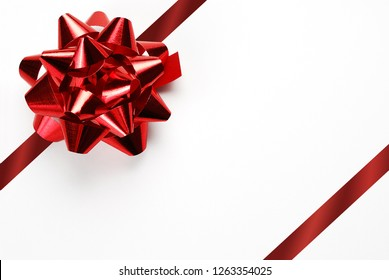 Blank white Gift Card with Red Bow and Ribbon