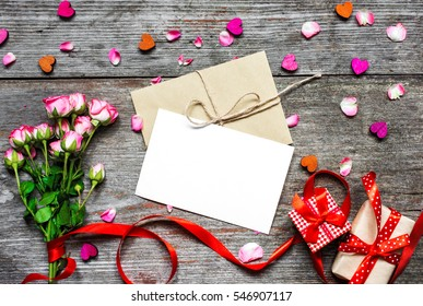 Blank white greeting greeting card blank stock photo royalty free blank white greeting greeting card with envelope pink roses wooden hearts red ribbon m4hsunfo Images