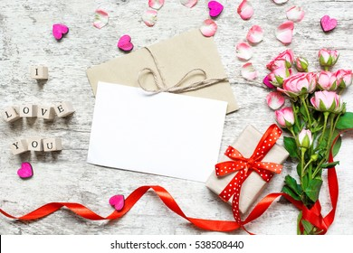 Blank white greeting greeting card blank stock photo royalty free blank white greeting card mockup with pink roses bouquet gift and wooden hearts to display m4hsunfo Images