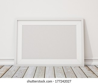 blank white horizontal picture frame on the wall and the vintage floor