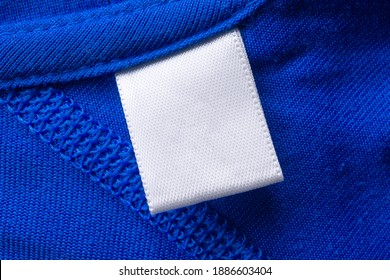 Blank white laundry care clothes label on blue fabric texture background - Shutterstock ID 1886603404