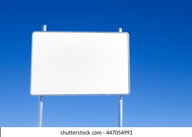 Blank white metal advertising billboard on blue sky background