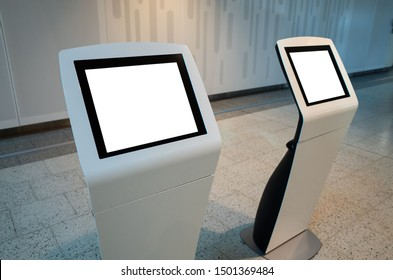 Blank white mock up template of two touch screen kiosk machines.