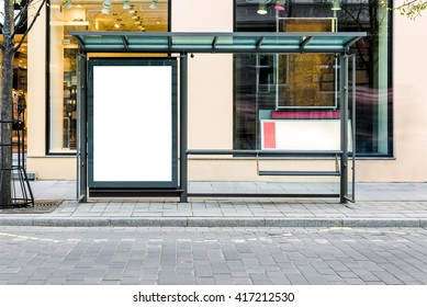 Blank white mock up of vertical light box in a bus stop. Front view