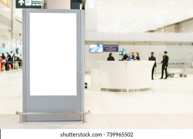 Blank white mock up of vertical light box billboard at the airport