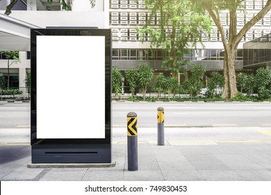 Blank white mock up of vertical light box billboard at bus stop station