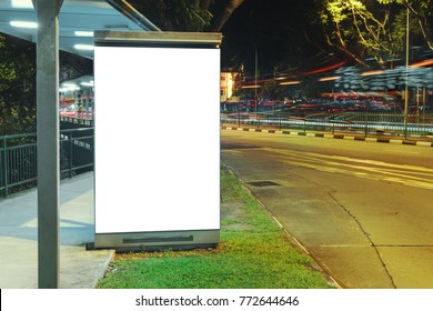 Blank white mock up of vertical light box billboard at the bus stop