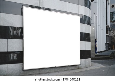 Blank white mockup of bus stop vertical billboard in front of empty street background.