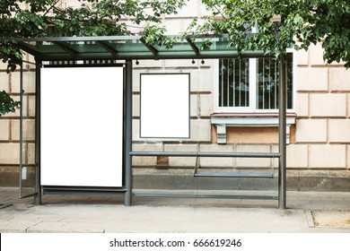 Blank white mockup of bus stop vertical billboard in front of empty street background