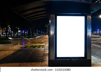 Blank white mockup in kiosk at night