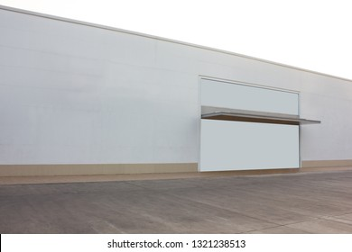 Blank white modern warm storefront with parking space and display wall in front, for retail business commercial branding mockup and billboard advertising.