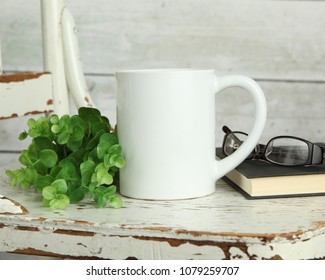 Blank white mug mockup photo with rustic wood background and book
