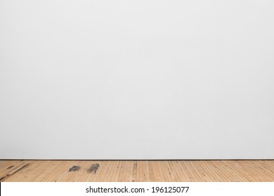Blank White Museum Wall With Wooden Floor