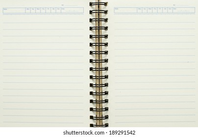 Blank white notebook paper with black wire.