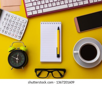 Blank white notepad with office and personal accessories isolated on yellow background, Business motivation and inspiration concepts.