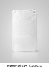 Blank white paper bag package of flour on gray background with clipping path
