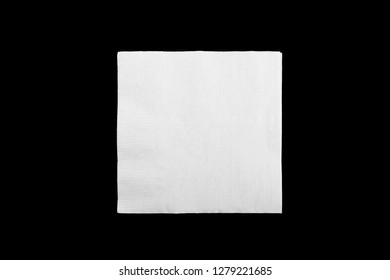 Blank white paper napkin on black background with copy space. Flat lay.