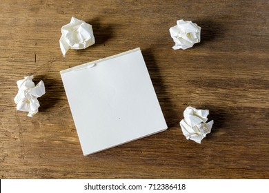 Blank of white paper note and crumpled paper for your add text your own idea on wood table.