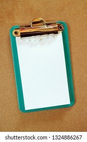 Blank white paper notepad with torn off pages on a clipboard and copy space for your text