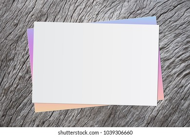 Blank white paper on old wooden background for text input.