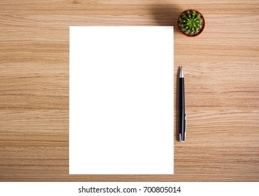 blank white paper on wooden table