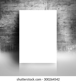 Blank White Paper Poster Leaning on Grunge Gray Studio Room Wall as Copy Space for Design and Template Mock up for Adding Your Text.