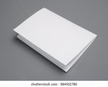 blank white paper with shadows, isolated on gray background