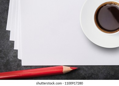 Blank white paper sheets. red pencil and a cup of coffee.