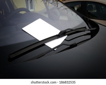 Blank white paper under the windshield wipers.