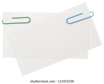Blank white papers connected with staples