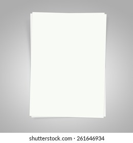 Blank white papers on a gray background with shadows