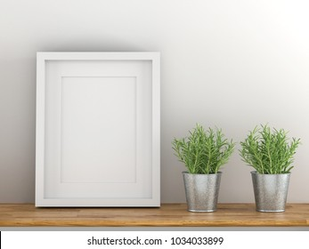 Blank white picture frame template for place image or text inside with a little tree on wood table.
