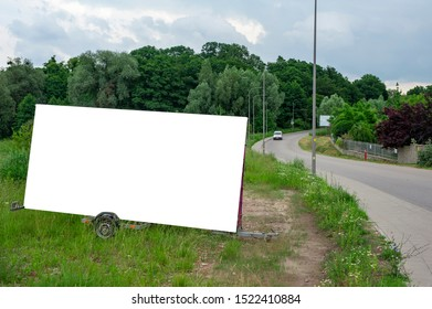 Blank white portable billboard mockup mounted on the trailer
