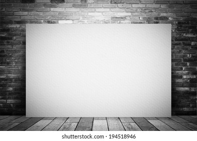 Blank white poster and brick wall.