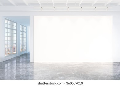 Blank white poster on white wall in empty loft room with concrete floor and big windows, mock up 3D Render