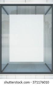Blank white poster in showcase, mock up