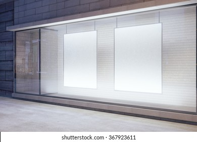 Blank white posters in the window on night empty city street, mock up 3D Render