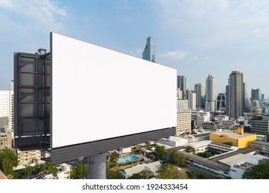 Blank white road billboard with Bangkok cityscape background at day time. Street advertising poster, mock up, 3D rendering. Side view. The concept of marketing communication to promote or sell idea.