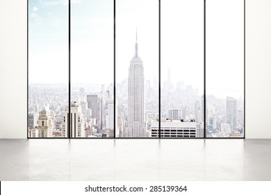 Blank white room with city view