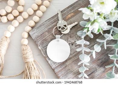 Blank white round sublimation key chain on wood background mockup