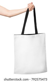 Blank of white shopping bag in woman's hand. Isolated on white background.